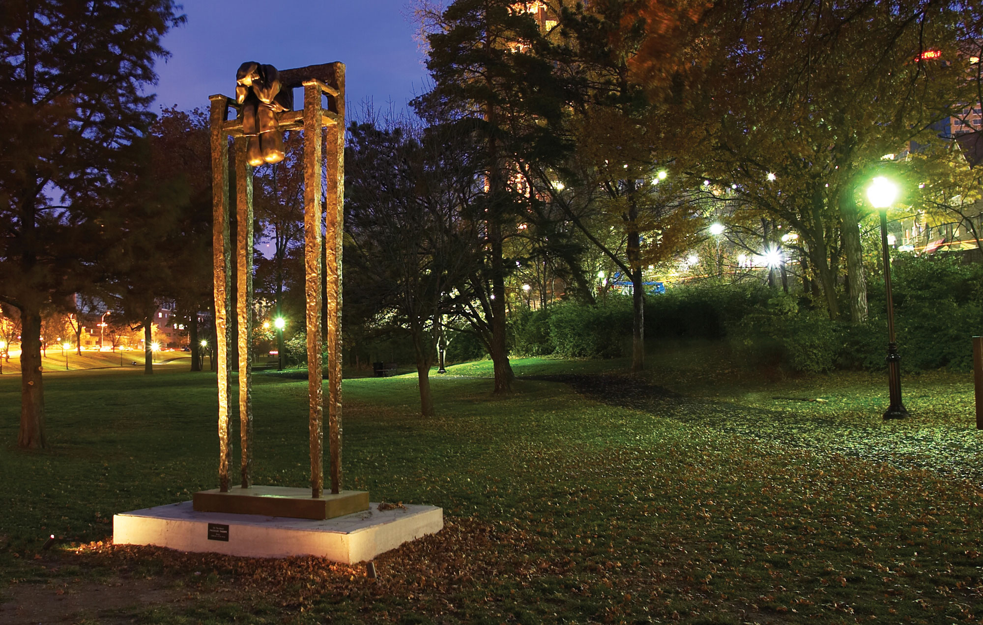 On the bench sculpture at night Mackenzie Thorpe