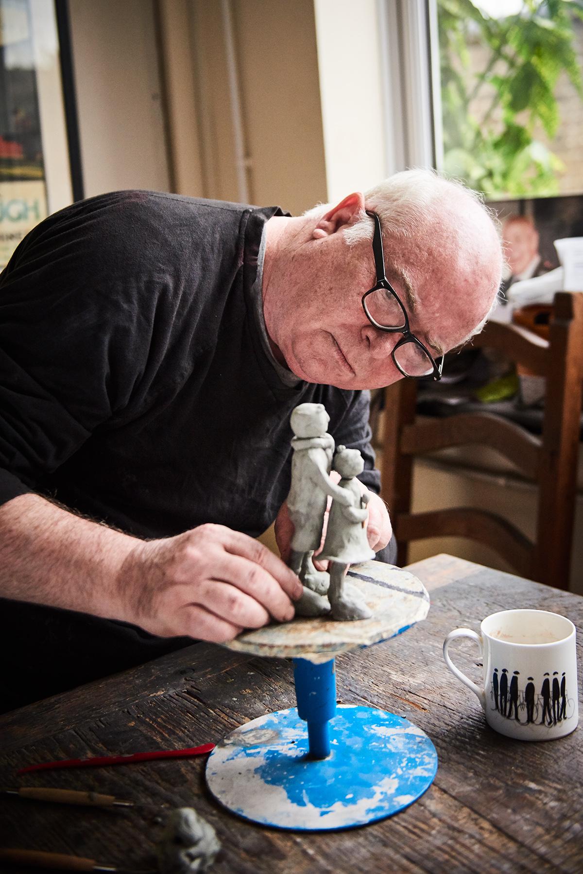 Artist Mackenzie Thorpe working on sculpture