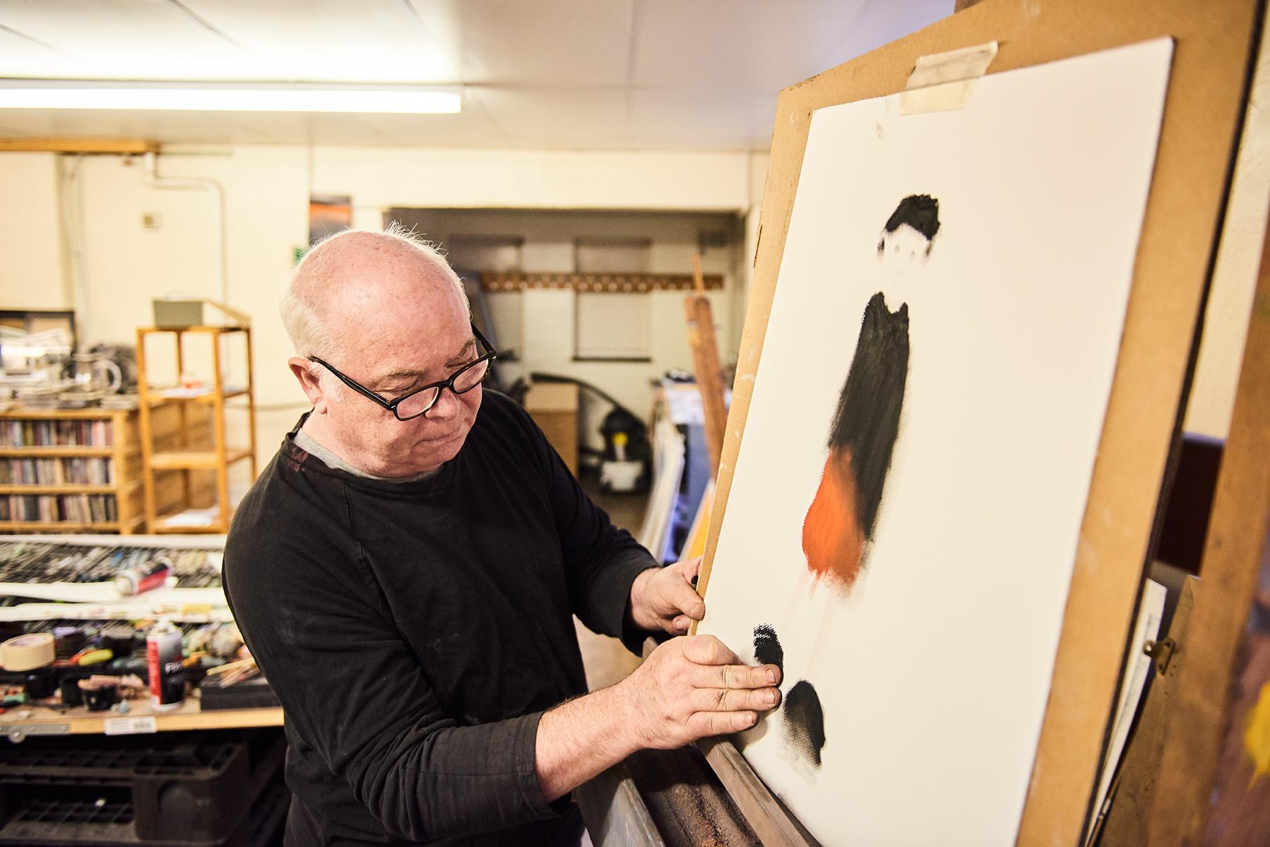 Artist Mackenzie Thorpe working on easel